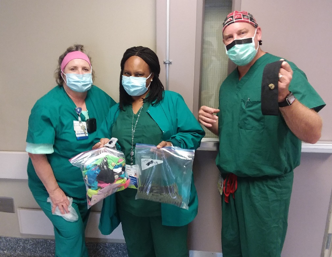 Nurses at Duke Regional Hospital express their gratitude for the gift. From left to right: Eva McCullock, BSN, RN, CNOR, Rene' Livingston Flowers, MHA, BSN, RN, CNOR and Shannon Lamb, CRNA.