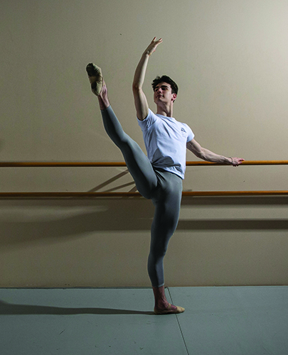 Clark Eselgroth in ballet pose at bar