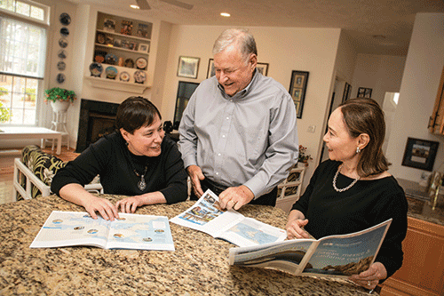 Meg and Bill Lindenberger with daughter, Kim, at the dining table