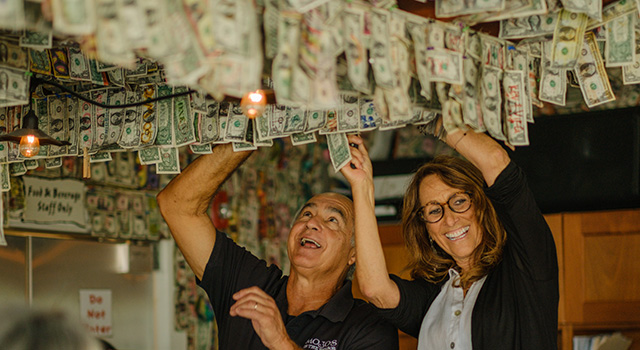 John and Andrea take the dollar bills down to donate them to pancreatic cancer research at Duke.