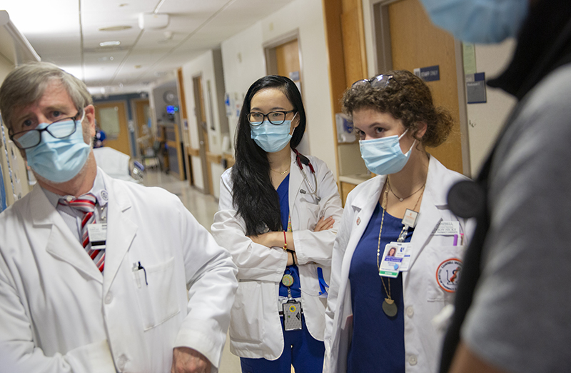 Fourth-year MSTP student Amy Petty, center, rounds with Richard Drew, PharmD, MS, and Madison Hicks at Duke University Hospital. Photo by Shawn Rocco.