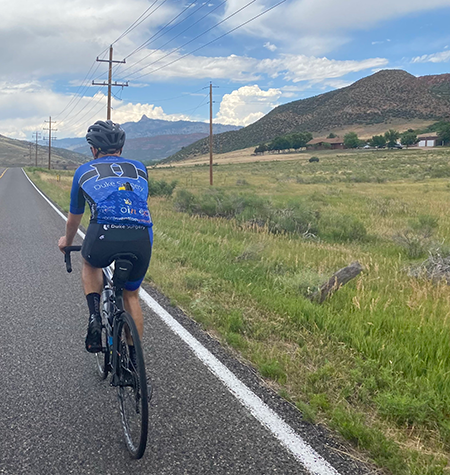 Ricky Romersi, a senior chemistry and environmental science student, rides in Fort Collins, Colorado.