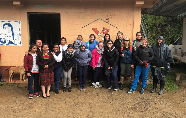 Strockbine with fellow nursing students and community health workers at Curamericas Global's casa maternal facility in Guatemala, where they document health information from local families.