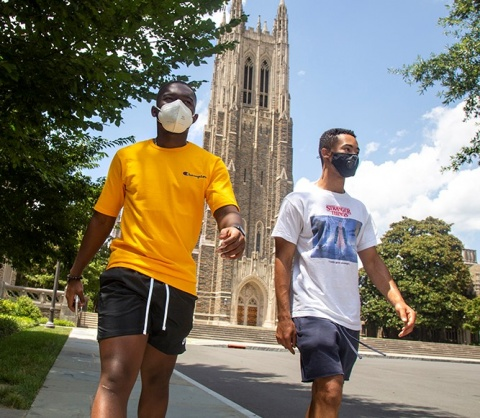 Prince Boadi, left, tours the campus with fellow first-year student John Atwater.  Photo by Shawn Rocco.
