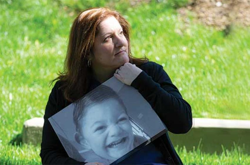 Stacy Sorenson holds a photo of her son Ryan, who passed away in 2016.